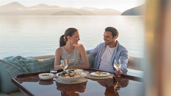 Couple enjoying lunch in the Marlborough Sounds